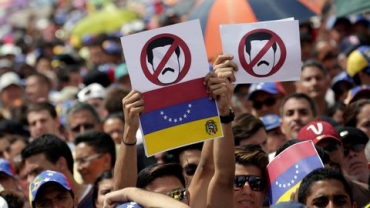 opposition-supporters-take-part-in-a-rally-against-venezuela-s-president-nicolas-maduro-s-government-in-caracas-2_5860279.jpg