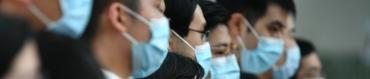 7800150156_des-personnes-masquees-pour-se-proteger-du-coronavirus-illustration.jpg