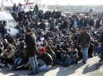 1472448142-afflux-d-immigrants-tunisiens-sur-l-ile-italienne-de-lampedusa.jpg